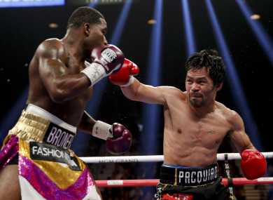 Manny Pacquiao throws a right to Adrien Broner in the WBA welterweight title boxing match in Las Vegas.