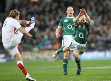 Peter Stringer dives to block Andy Goode's kick as Ireland chased the Grand Slam in 2009.