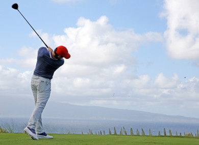 Rory McIlroy tees off on the 18th hole at Kapalua Resort.