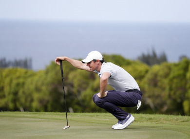 Rory McIlroy lines up a putt on the 14th hole yesterday.
