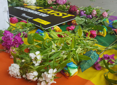 Flowers laid on a flag outside the Russian embassy in London during a protest against a purge of gay men in Chechnya in 2017