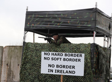 An actor in military fatigues takes part in an anti-Brexit rally at the Irish border near Carrickcarnan, Co Louth.