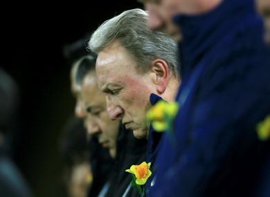 Neil Warnock bows his head in remembrance of Emiliano Sala.