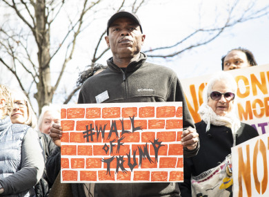 A demonstrator in Atlanta, Georgia protests against Donald Trump's declaration of a national emergency to fund a border wall with Mexico