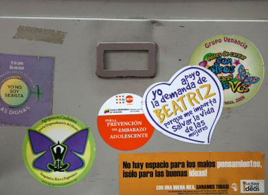 Anti-abortion stickers on a wall in El Salvador