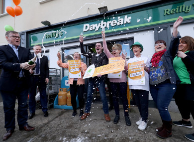 Michael Hayes (left) from the National Lottery sprays champagne as Les Reilly (centre) and the staff of Reilly's Daybreak in Naul, Co Dublin, celebrate selling the EuroMillions €175 million winning lotto ticket.