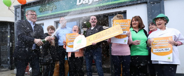 Michael Hayes (left) from the National Lottery sprays champagne as Les Reilly and the staff of Reilly's Daybreak in Naul, Co Dublin, celebrate selling the EuroMillions €175 million winning lotto ticket.