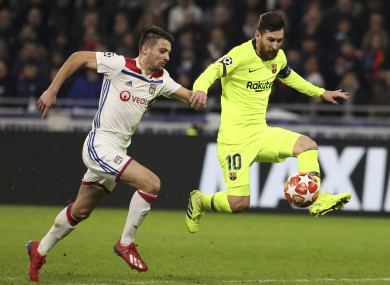 Lyon defender Leo Dubois and Lionel Messi in action on Tuesday.