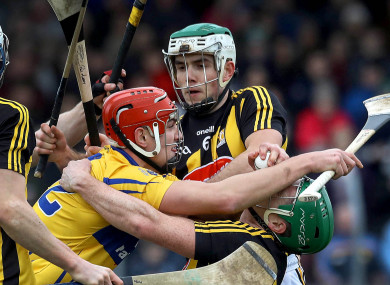 Clare's Ian Galvin tackled by Paddy Deegan and Paul Murphy of Kilkenny.