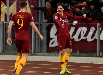 Nicolo Zaniolo celebrates with Edin Dzeko having put Roma 2-0 up.