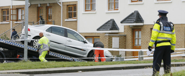 Gardaí removing a vehicle for forensic inspection.