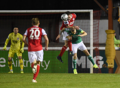Kevin Toner wins a header above Karl Sheppard.