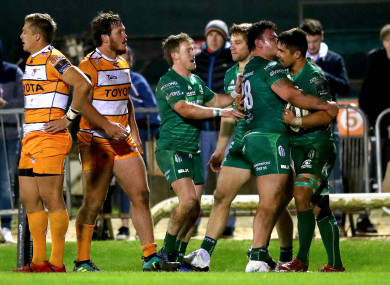 Connacht's Kieran Marmion and Dominic Robertson-McCoy celebrate with try-scorer Jarrad Butler.