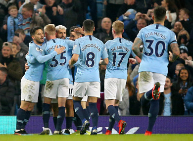 The City players celebrating their first goal against West Ham last night.