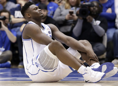 Duke's Zion Williamson sits on the floor following an injury.