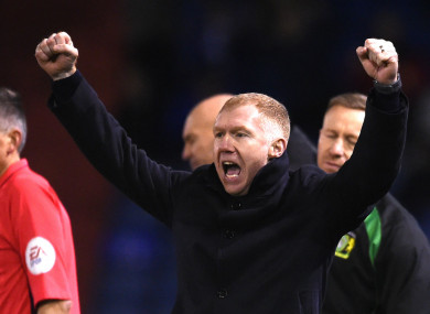 Oldham Athletic manager Paul Scholes celebrates one of four goals scored by his side during his first game in charge.