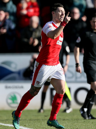 Richie Towell celebrates after scoring for Rotherham United against Sheffield Wednesday.