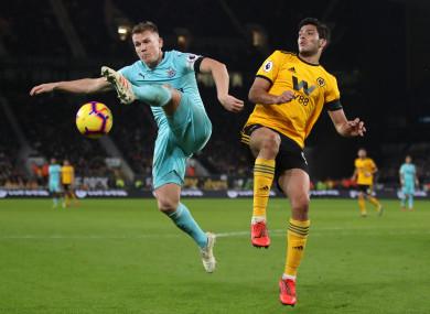 Newcastle United's Matt Ritchie and Wolverhampton Wanderers' Raul Jimenez.
