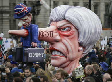 An effigy of British Prime Minister Theresa May is wheeled through Trafalgar Square during an anti-Brexit march in London on Saturday.