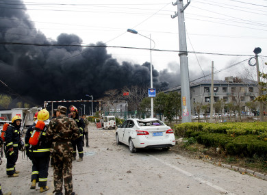 Rescuers walk near the site of the factory explosion in Yancheng.
