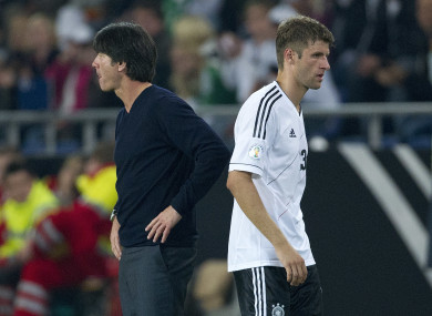 Mueller (right) is unhappy with the German international manager (left).
