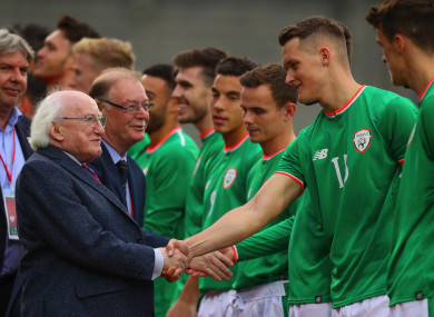Sean McLoughlin meets President Michael D Higgins before playing for Ireland U21s against Germany.