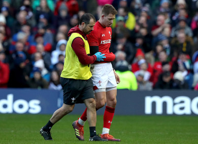 Liam Williams helped off the field after being run down by Allan Dell.