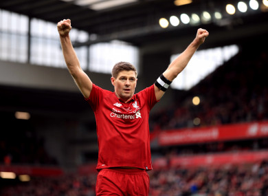 Gerrard celebrates scoring during the Legends match at Anfield against AC Milan.