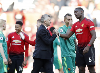 The Norwegian shakes hands with Paul Pogba after full-time at Old Trafford.