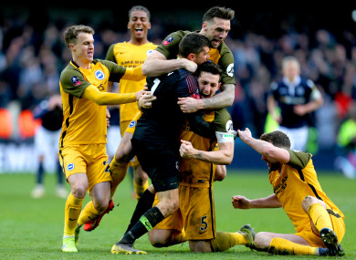 Brighton celebrate their dramatic shootout win.