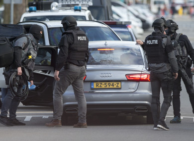 Dutch counter terrorism police leave after searching a house following the shooting incident in Utrecht, Netherlands
