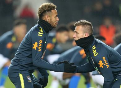 Brazil team-mates Neymar and Arthur.