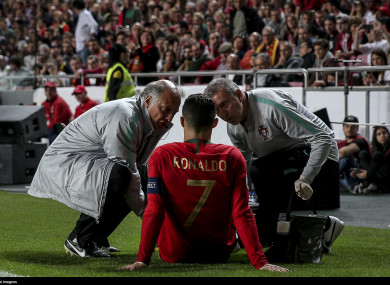 Ronaldo receiving treatment during his side's draw against Serbia.