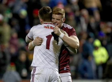 Ruairi Lavelle and Sean Andy Ó Ceallaigh celebrate after the game.