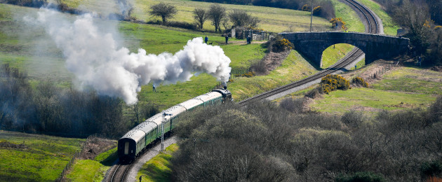 A steam train winds its way across the Dorset countryside.