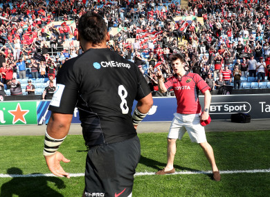 The Saracens player is greeted by an irate fan.