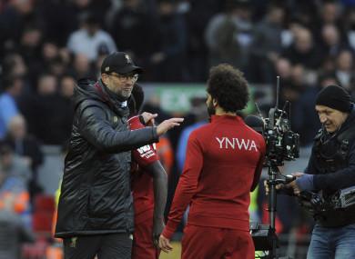 Jurgen Klopp, left, celebrates with Mohamed Salah.