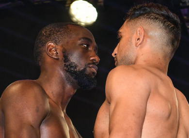 Terence Crawford and Amir Khan face up to each other after weighing in for their welterweight fight.