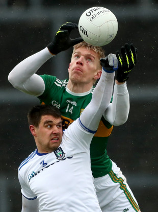 Tommy Walsh contesting the ball with Monaghan defender Drew Wylie.