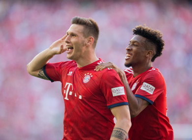 Niklas Süle celebrates with Kingsley Coman after giving Bayern the lead.