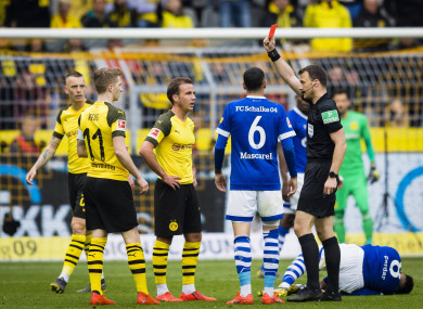 Marco Reus receiving a red card during his side's defeat.