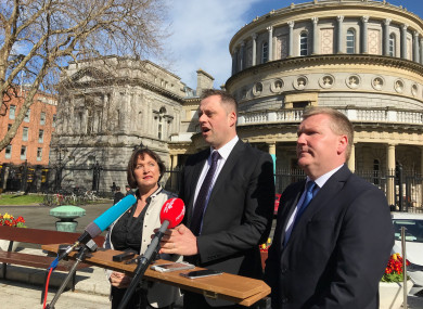 Fianna Fáil's Thomas Byrne TD (centre) speaking to reporters outside Leinster House today