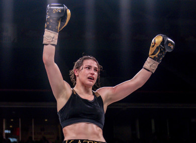 Katie Taylor celebrates her world-title unification victory over Rose Volante in March.