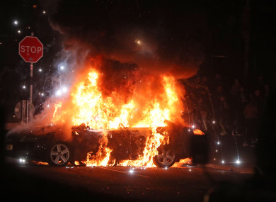 A burning car in CregganDerry after petrol bombs were thrown at police last night