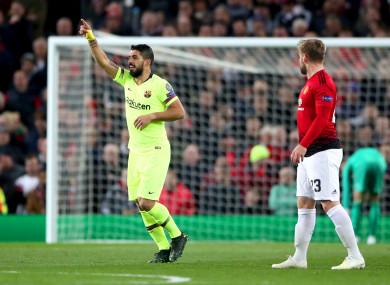 Luis Suarez celebrates Barcelona's first-half goal.
