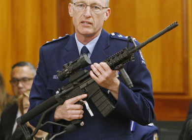Police acting superintendent Mike McIlraith shows New Zealand lawmakers an AR-15 style rifle similar to one of the weapons a gunman used to kill 50 people at two mosques.