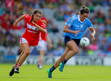 Dublin's Niamh McEvoy on the ball as Eimear Meaney chases her down.