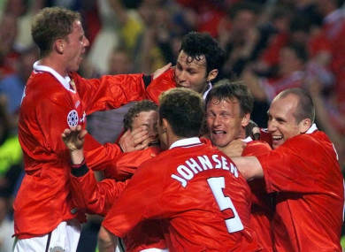 Solsjkaer is mobbed by team-mates after his winner in the 1999 Champions League final.