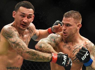Dustin Poirier lands on Max Holloway.