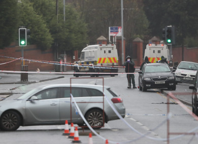 Police at the scene where Jim Donegan was shot dead on the Glen Road in west Belfast